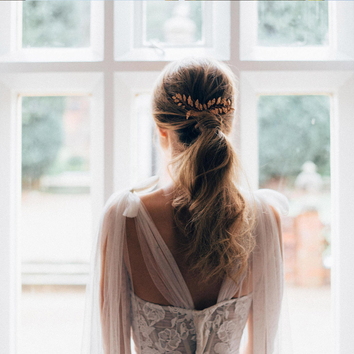 A bride looking out the window to the Italian Gardens