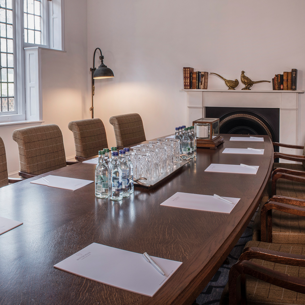 A meeting room with wooden boardroom table
