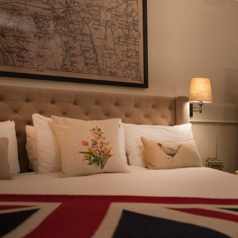 Guest room in the evening with British blanket