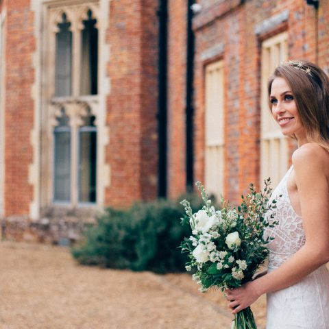 A bride posing for photos on the grounds